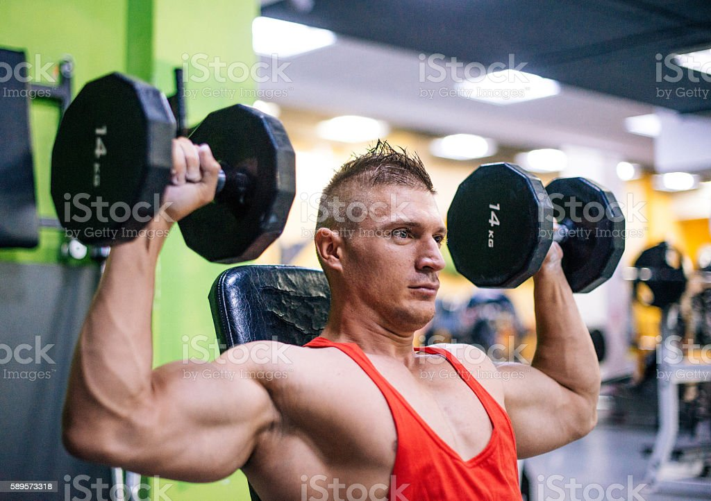 Extraordinary strength after successful workout in gym stock photo