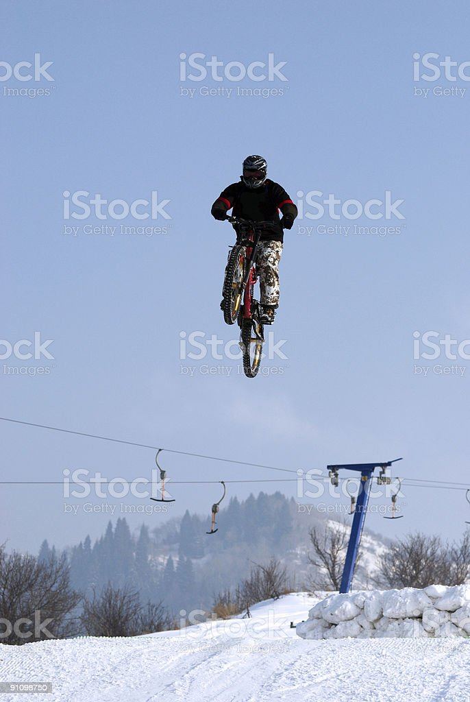 Extreme biker fly on big air royalty-free stock photo