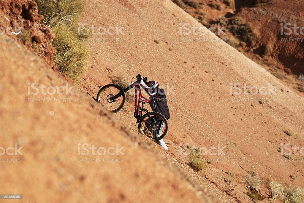 Extreme biker uphill in red canyon royalty-free stock photo