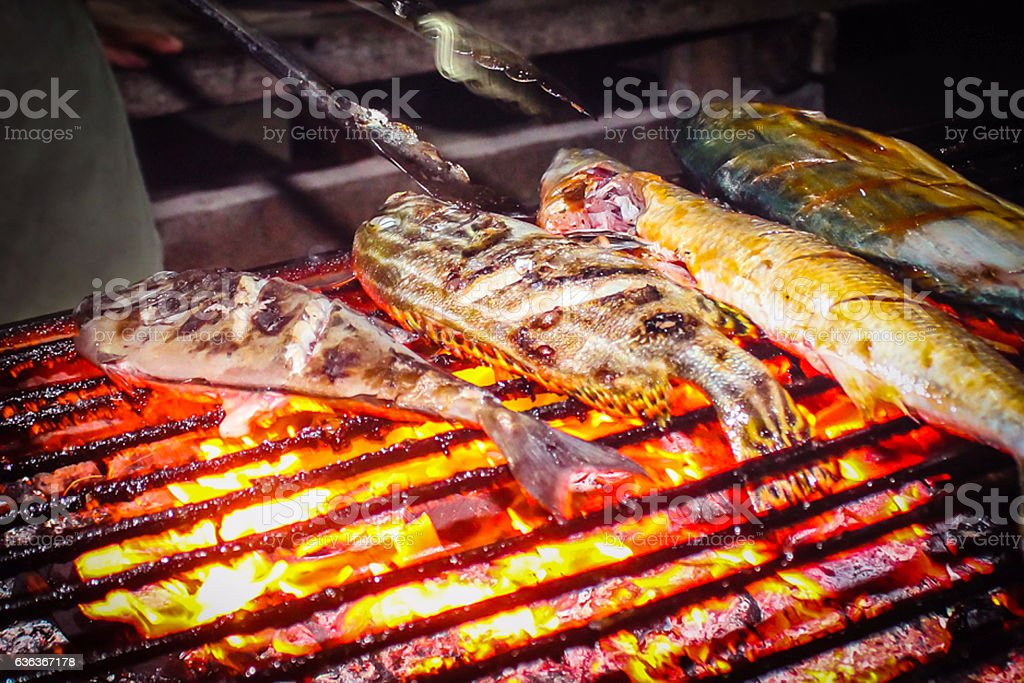 Extreme close up grilled fish on fire stock photo