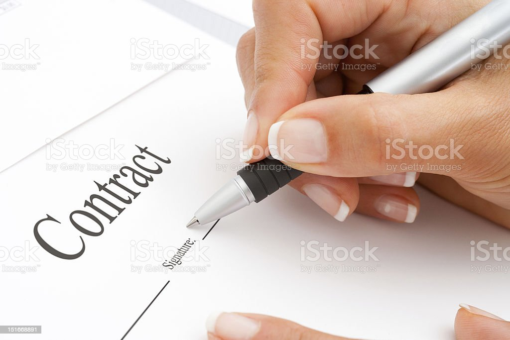 Extreme close up of hand signing. stock photo