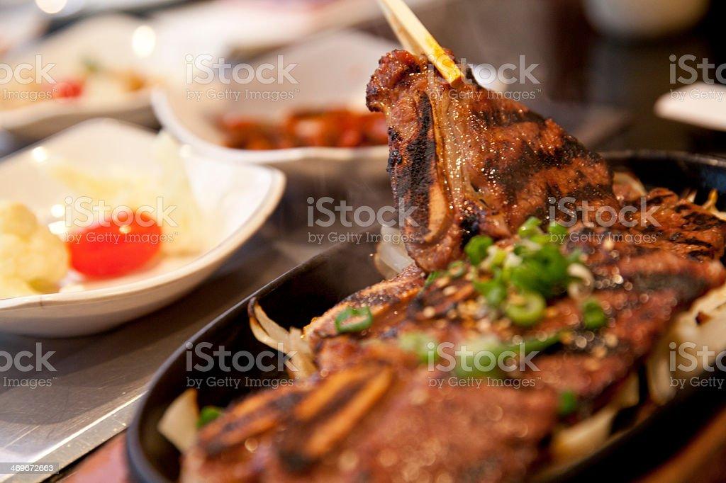 Extreme close up of Korean B Q Short ribs cooking stock photo