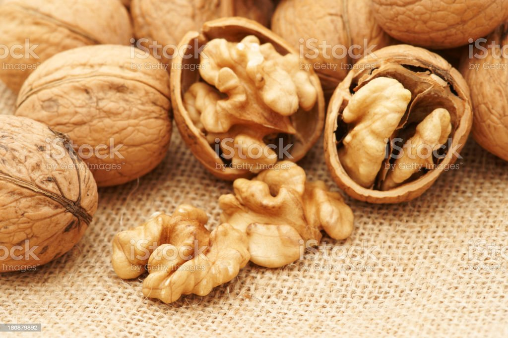 Extreme close up of walnuts with some cracked open royalty-free stock photo