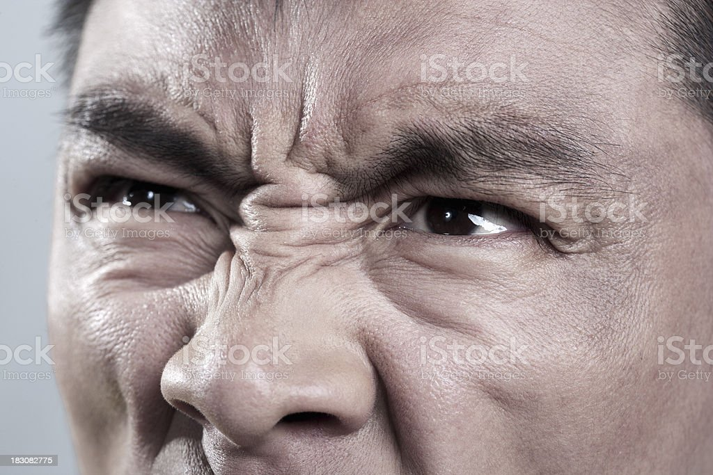 Extreme Close up on angry mans face royalty-free stock photo