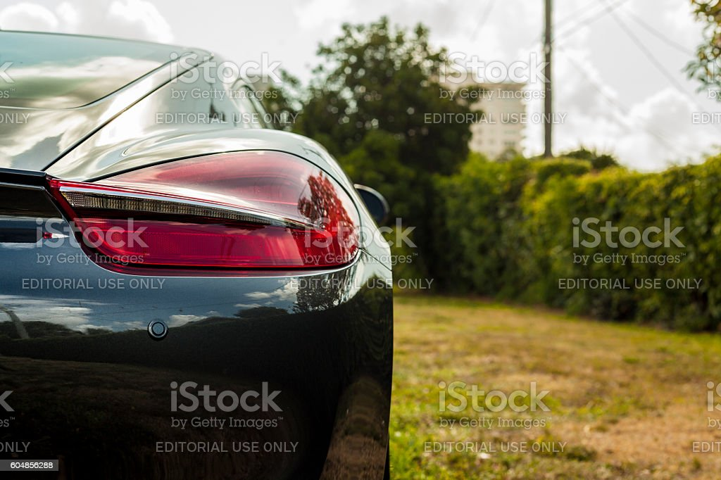 Extreme close up shot headlight. Porsche Cayman in residential area stock photo