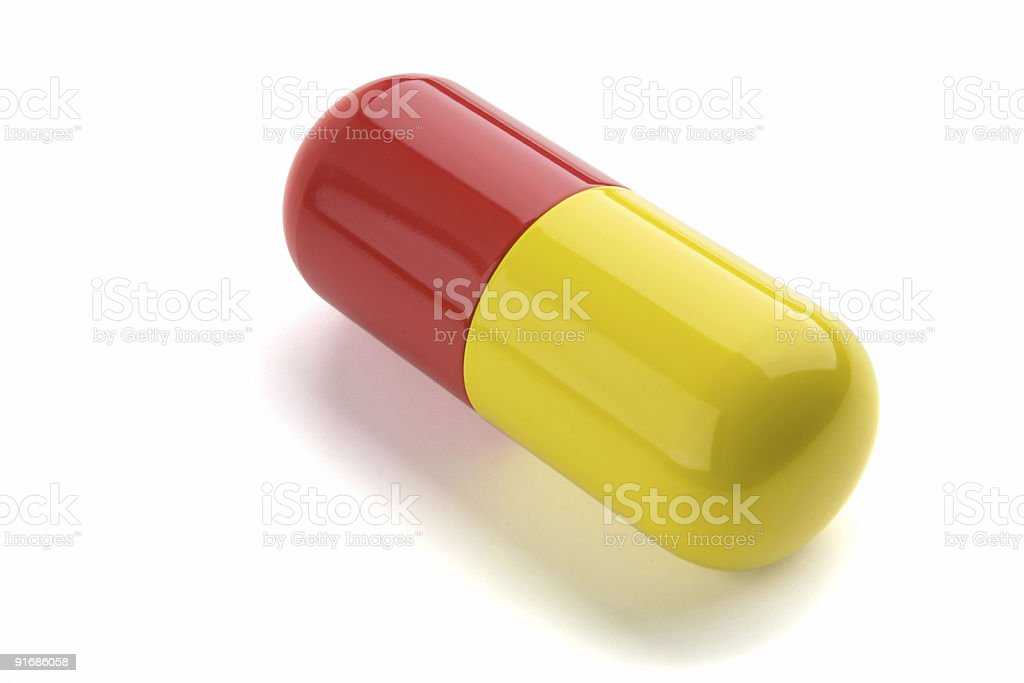 Extreme Closeup Isolated Red and Yellow Pill Diagonal Composition stock photo