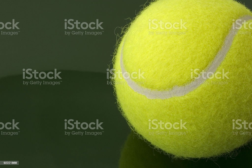 Extreme closeup of a yellow tennis ball. royalty-free stock photo