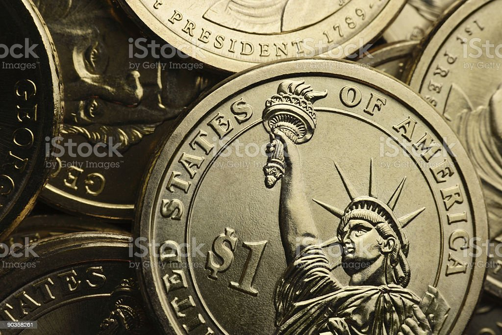 Extreme Closeup of Gold Liberty One Dollar Coins stock photo