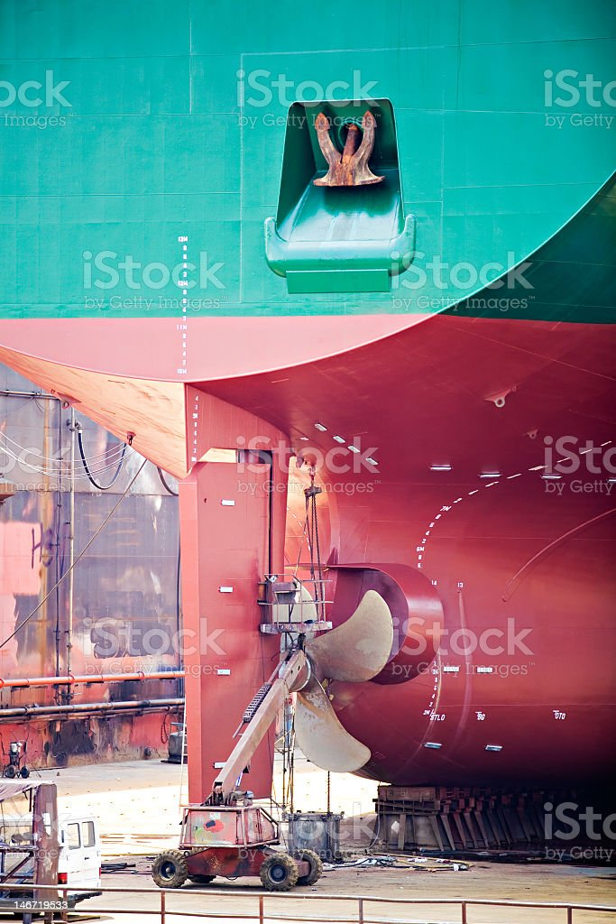 Extreme close-up of part of a blue and red ship in dry dock royalty-free stock photo