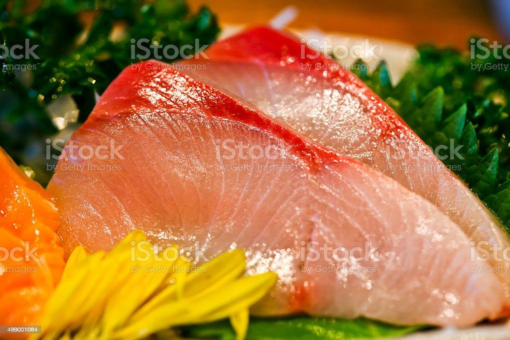 Extreme close-up of yellowtail sashimi stock photo