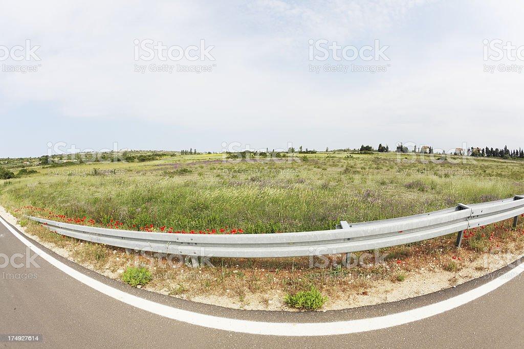 extreme fisheye curve ountry road through meadow near Zadar Croatia royalty-free stock photo