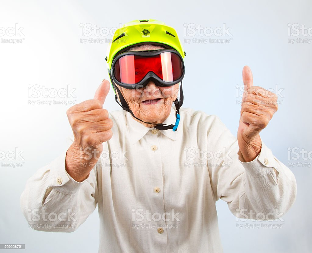 extreme grannie showing thumbs up stock photo