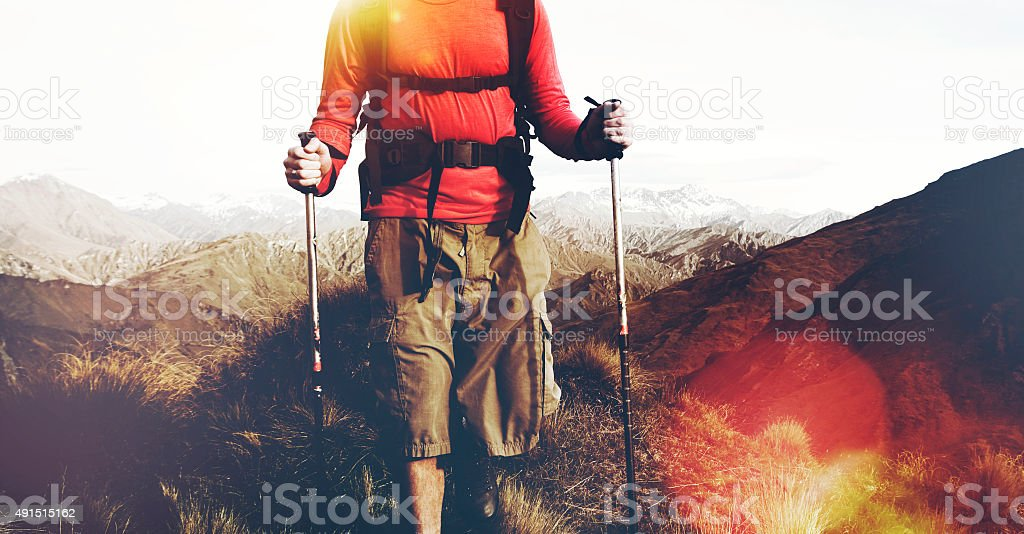 Extreme Hiking Across Rugged Mountains Concept stock photo