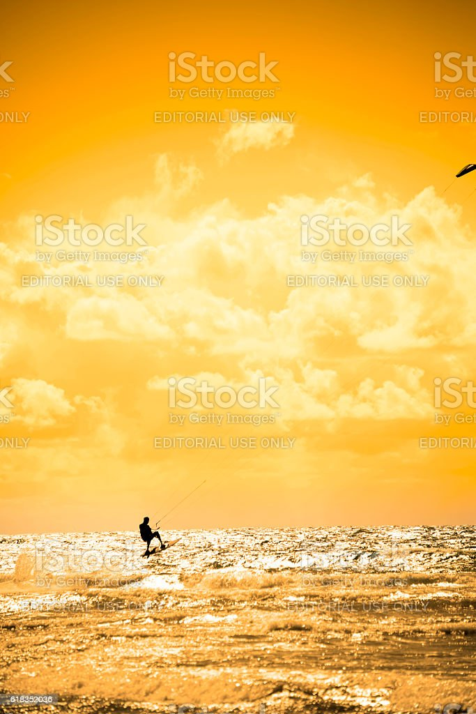 extreme kite surfer jumping waves stock photo