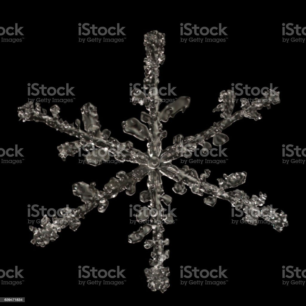 Extreme magnification - Real snowflake on black background stock photo