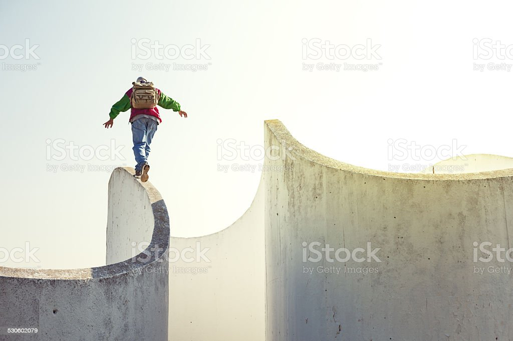 extreme man walking on concrete wall stock photo