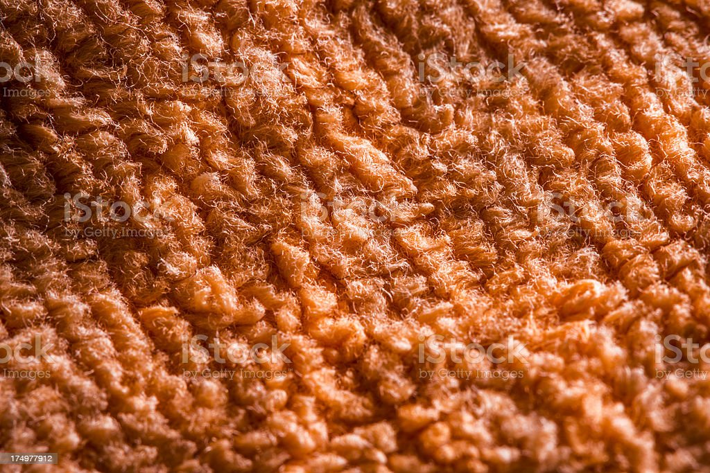 Extreme micro-macro fabric abstract background: Orange towel royalty-free stock photo
