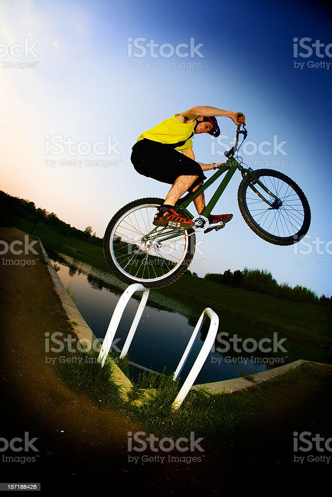 Extreme mountain biker jumping by water royalty-free stock photo