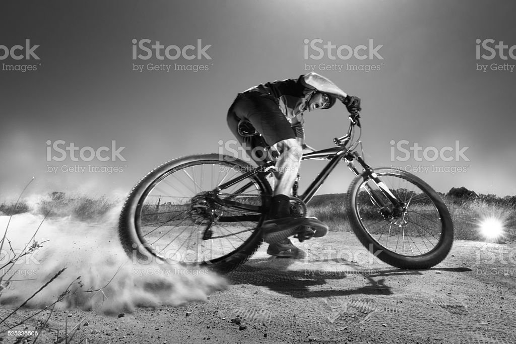 B&W Extreme Mountain Biker Jumping Off A Cliff stock photo