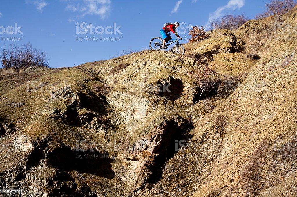 Extreme mountain biking on a rocky teraiin stock photo