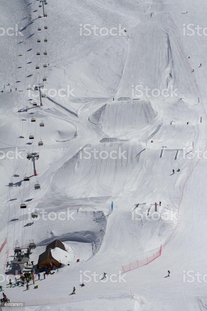Extreme park in mountain ski resort stock photo