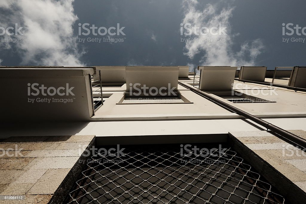 Extreme perspective view of building with balconies stock photo