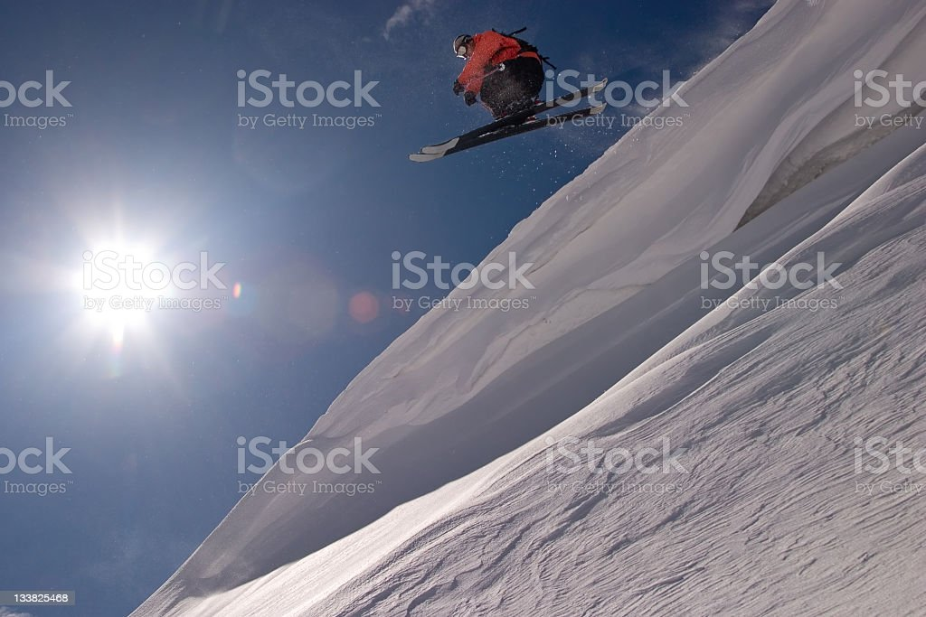 Extreme skier jumping off a big cornice royalty-free stock photo