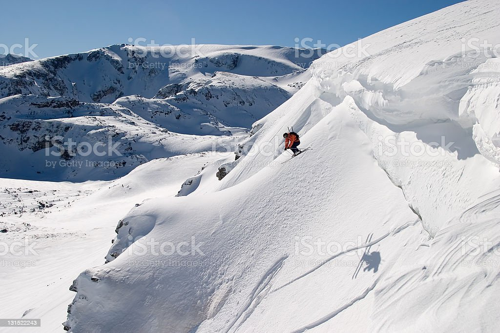 Extreme skier jumping off a cliff stock photo