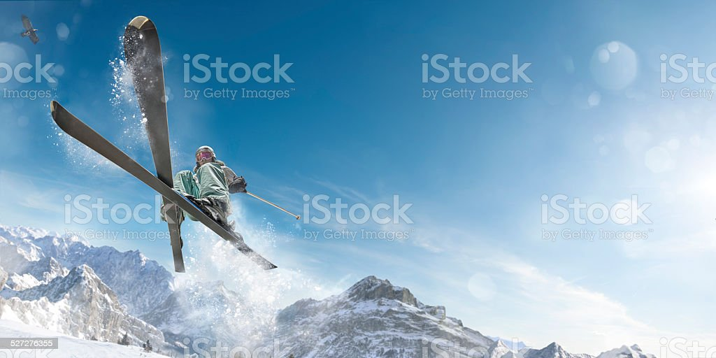 Extreme Skiing Girl in Mid Air Jump Action stock photo