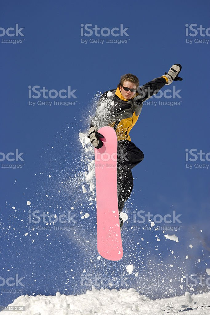 Extreme Snowboard Jump Against Blue Sky royalty-free stock photo