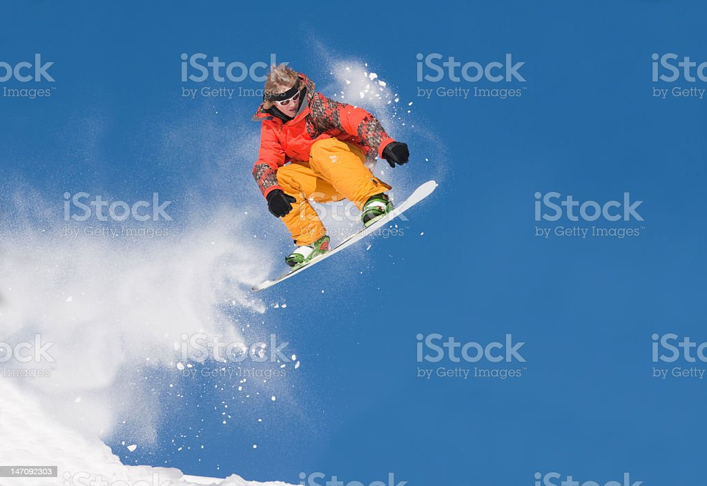 Extreme Snowboard Jump Against Clear Blue Sky stock photo