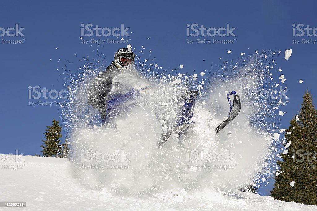 Extreme snowmobiling in bank of snow stock photo