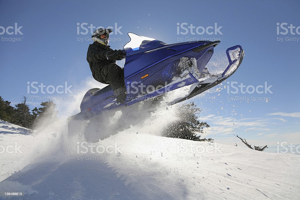 extreme snowmobiling stock photo