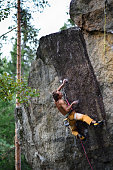 Extreme sport climbing. Young male rock climber.