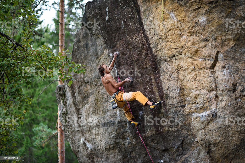 Extreme sport climbing. Young male rock. stock photo
