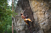 Extreme sport climbing. Young male rock.