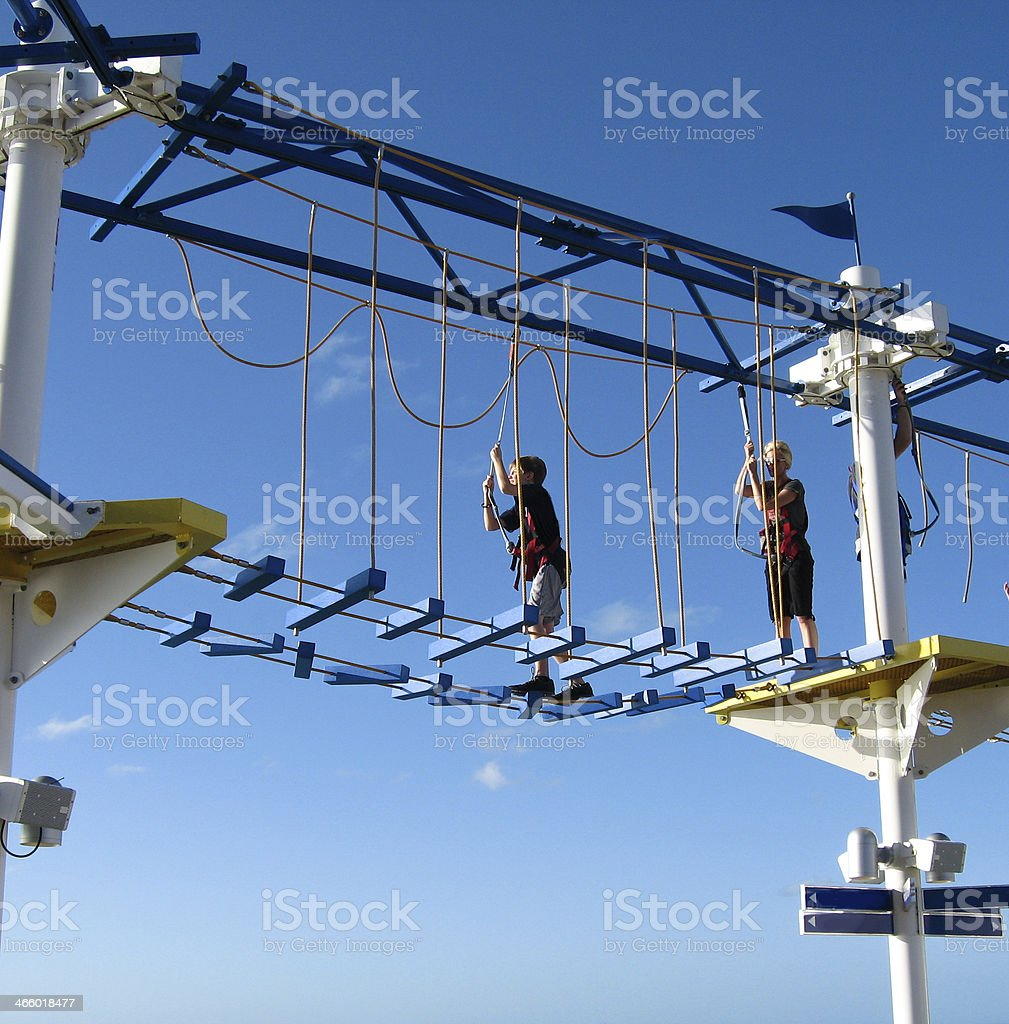 Extreme Sport: Mother, son do ropes course on cruise ship. stock photo