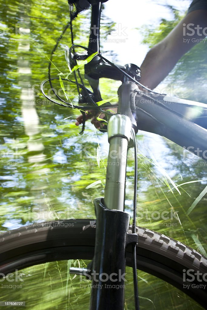 Extreme Sports. Dynamic perspective of mountain bike on trail royalty-free stock photo