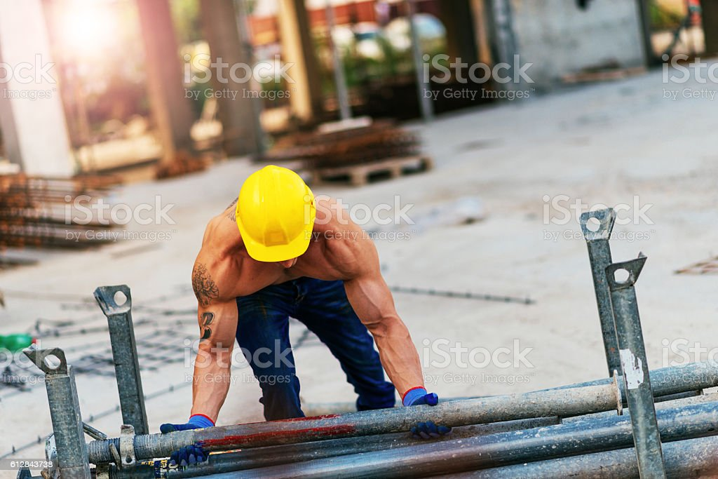 Extreme strength for young male worker stock photo