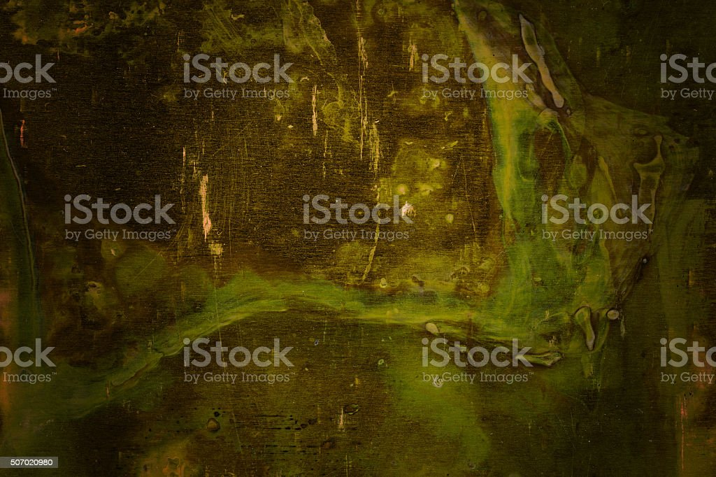 Extremely distressed green metal surface with vignette stock photo