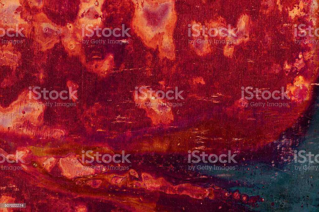 Extremely distressed red and black metal surface stock photo