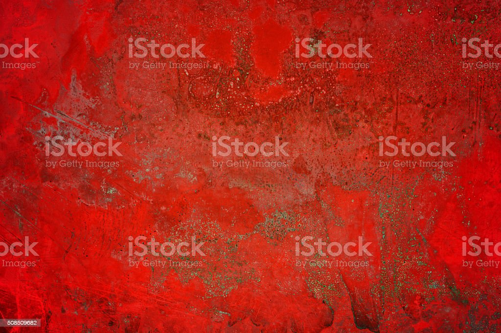 Extremely distressed red metal surface stock photo