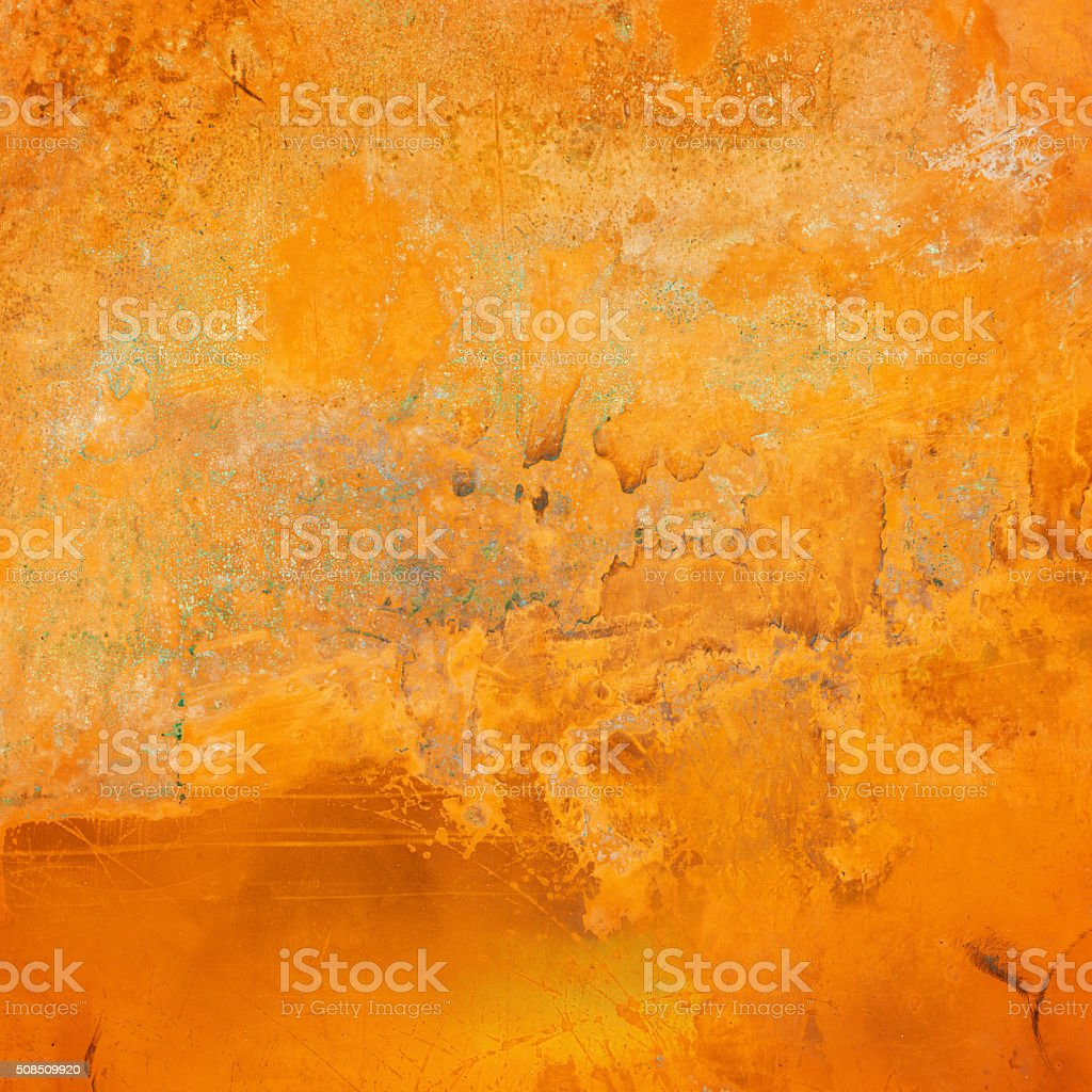 Extremely distressed yellow metal surface stock photo
