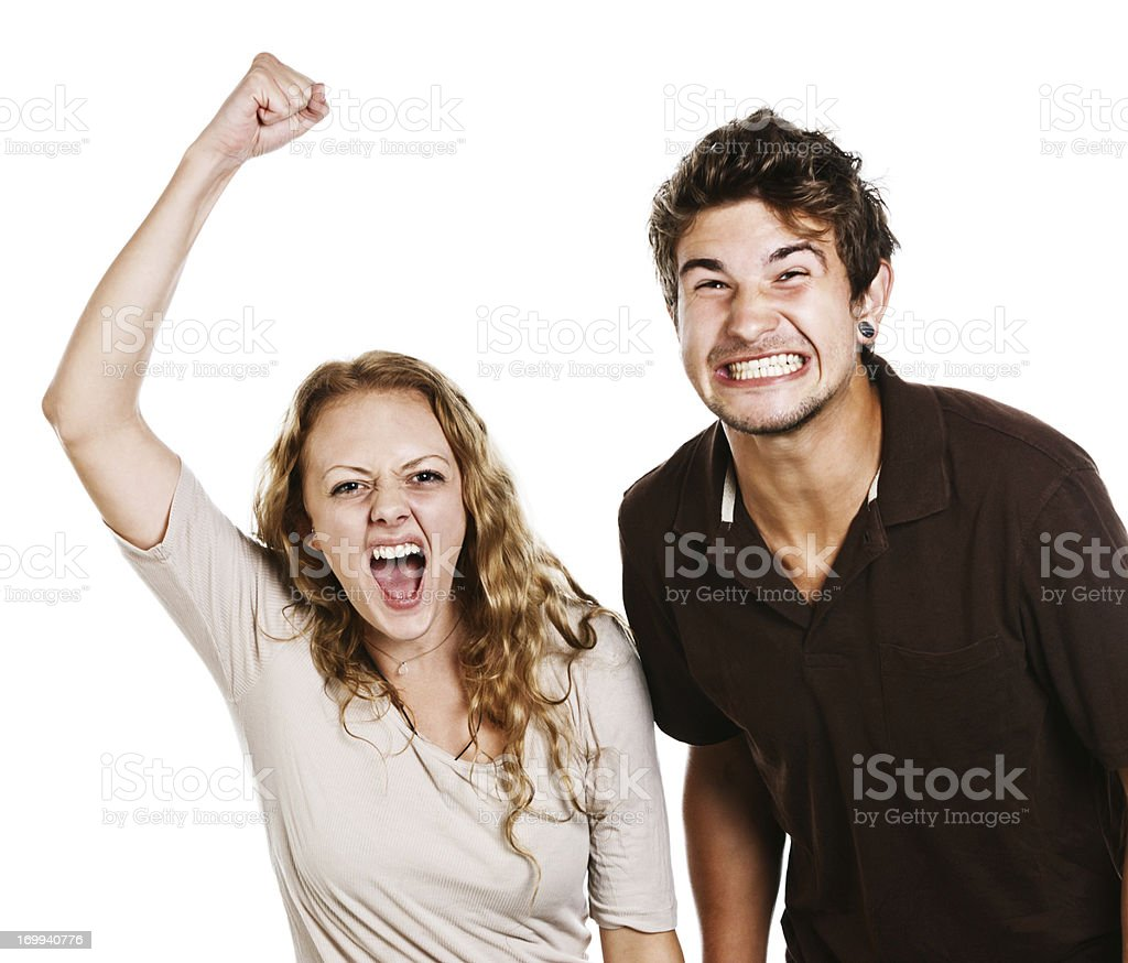 Extremely excited couple yell and gesticulate stock photo