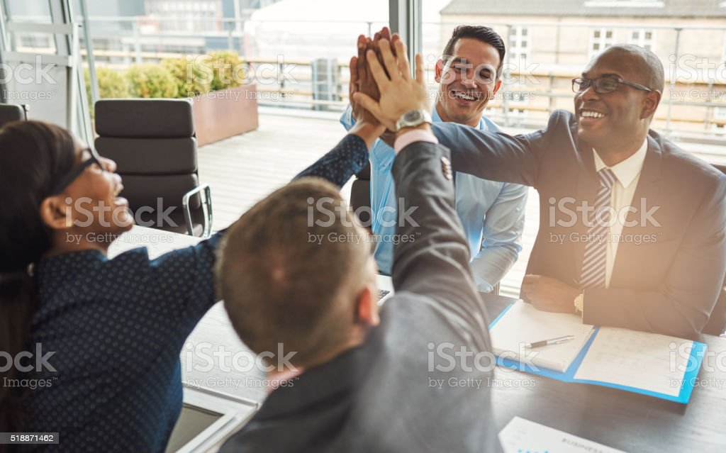 Exultant team of business professionals stock photo