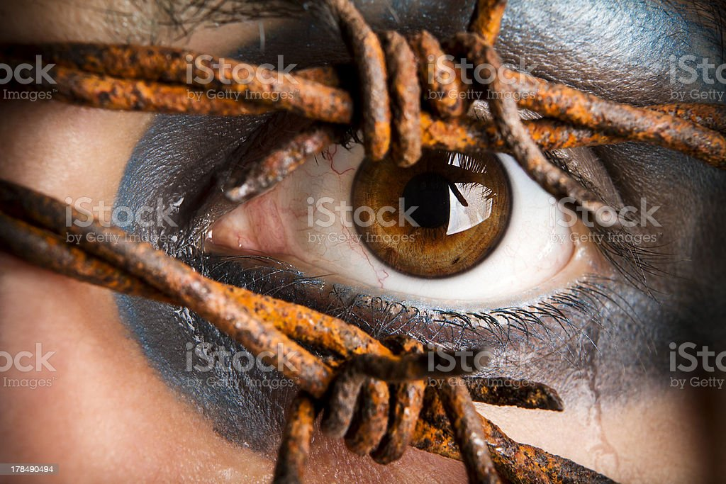 Eye and tears with barbed wire. royalty-free stock photo