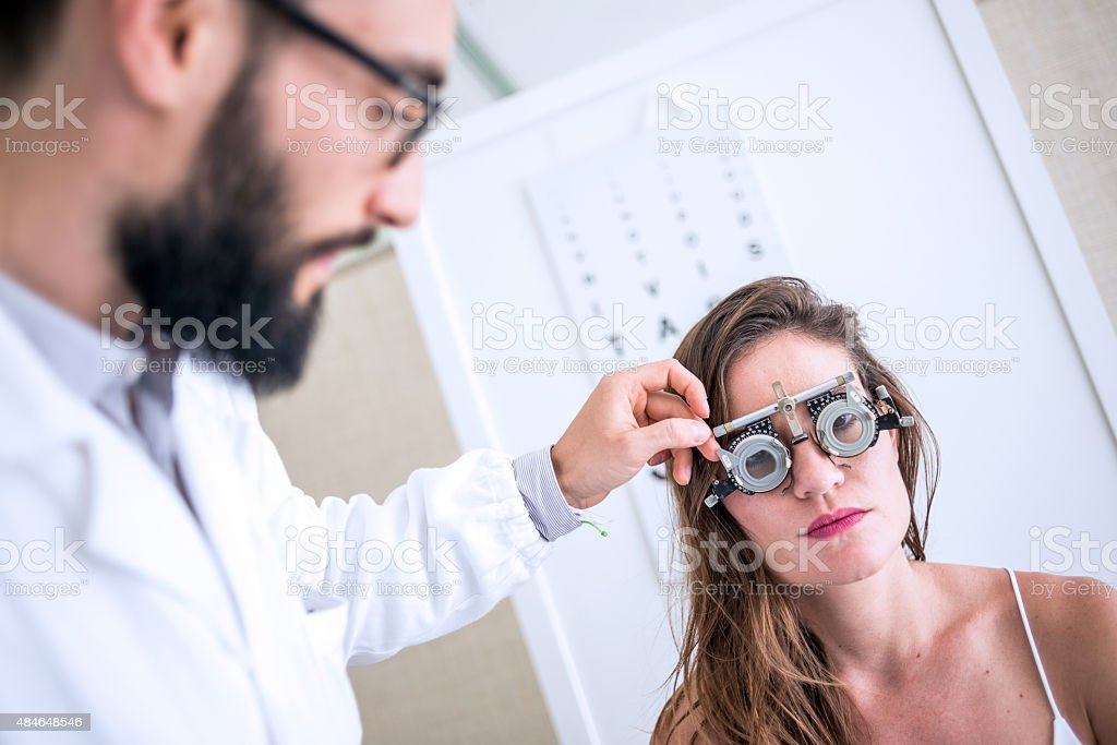 Eye doctor with patient stock photo