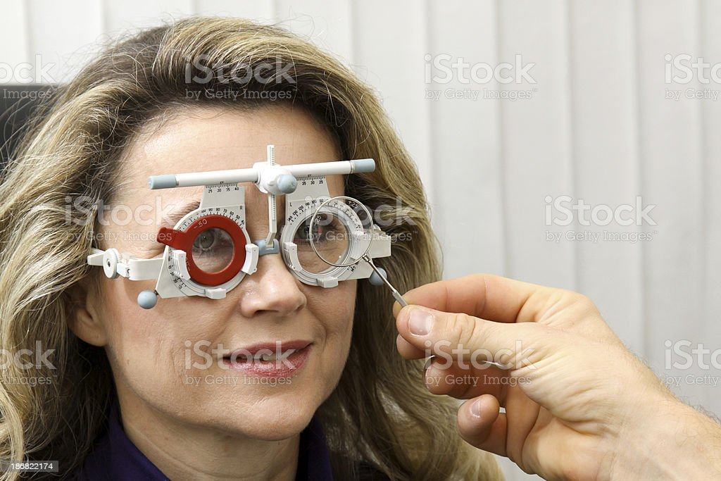 eye exam with measuring  glasses royalty-free stock photo
