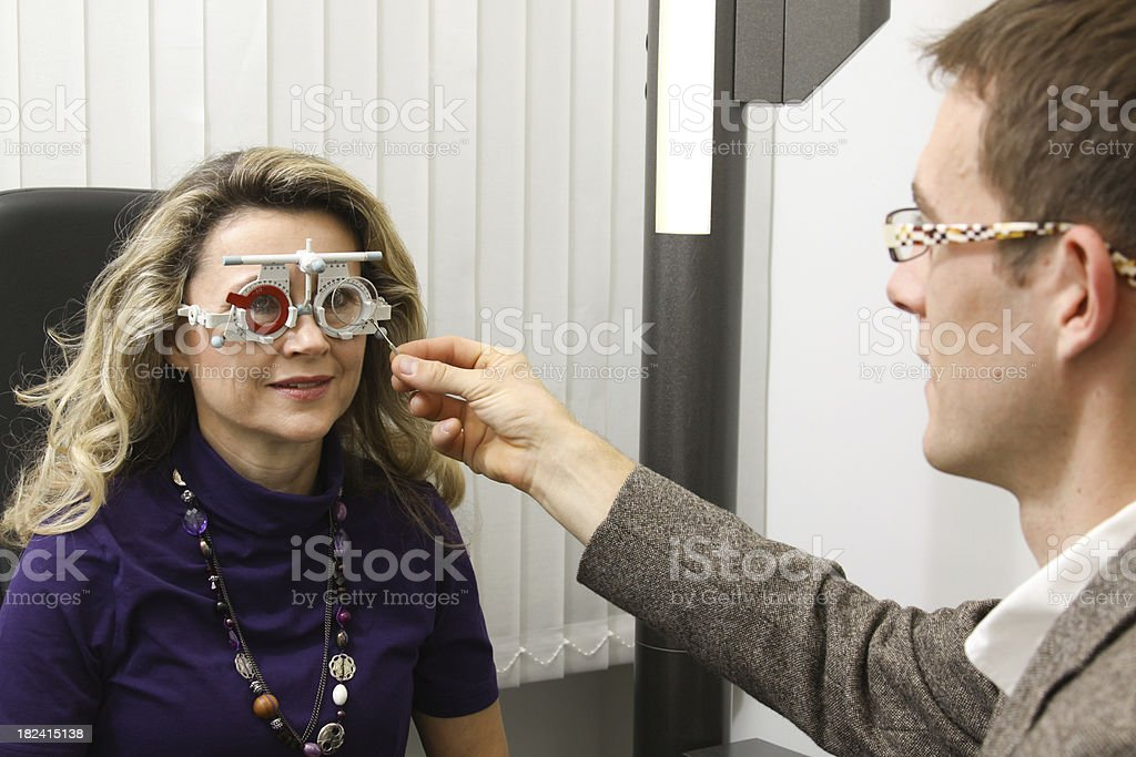 eye exam with measuring spectacles royalty-free stock photo
