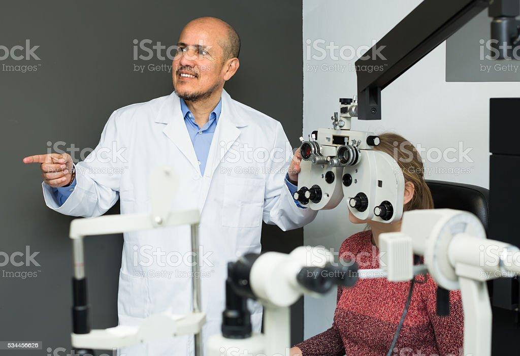 Eye examination at clinic stock photo